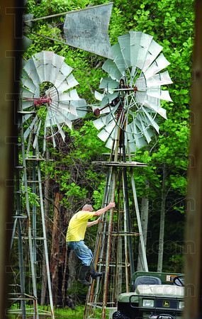 Mill management: Neal Yerian works on one of his windmills Friday afternoon on his Poland, Indiana property.