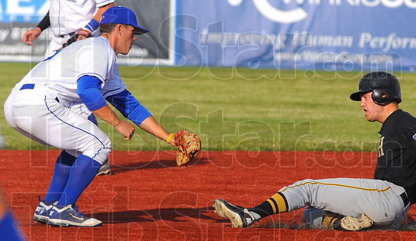 Tribune-Star/Jim Avelis<br /> Crime stopper: Jacob Hayes tags Hannibal's Kyle Haen in an attempted steal for the first out of their Prospect League game Wednesday evening at Bob Warn Field.