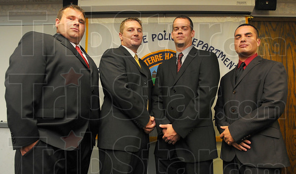 Tribune-Star/Jim Avelis<br /> To serve and protect: New Terre Haute Police officers are: Eric Atterson, Donald Toney, Jonathan Ringo and John Goldner.