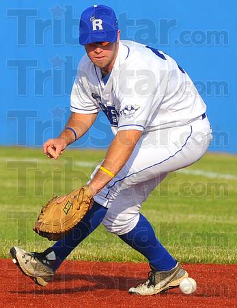 Tribune-Star/Jim Avelis<br /> Eye ball: Rex firstbaseman John Loeffler chases down a ground ball.