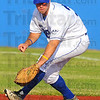Tribune-Star/Jim Avelis<br /> Eye ball: Rex firstbaseman John Loeffler chases down a ground ball.