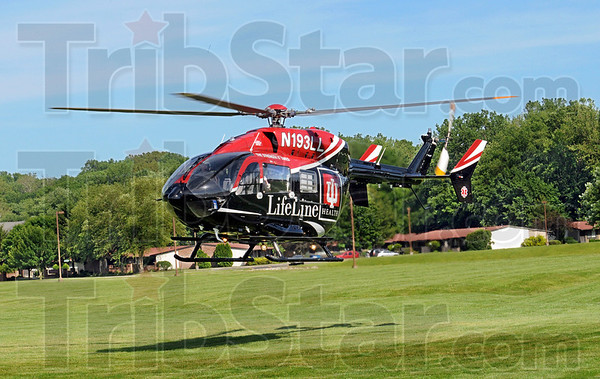 LifeLine: A helicopter lifts off from a field across from the entrance to the south Walmart Wednesday evening.