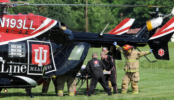LifeLine flight crew: The flight crew loads an injured victim from Wednesday's collision on US 41 at the entrance to the southside Walmart.