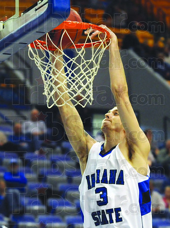 Throw-down: Indiana State's #3, Jake Kelly dunks the ball during game action against Wabash College Saturday afternoon.