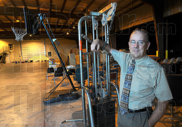 Tribune-Star/Jim Avelis<br /> On the block: Terre Haute International Airport is having a yard sale. Some 400 items, from trash cans to cement mixers are up for sale. Here airport director Dennnis Wiss stands by a workout station that will be sold.