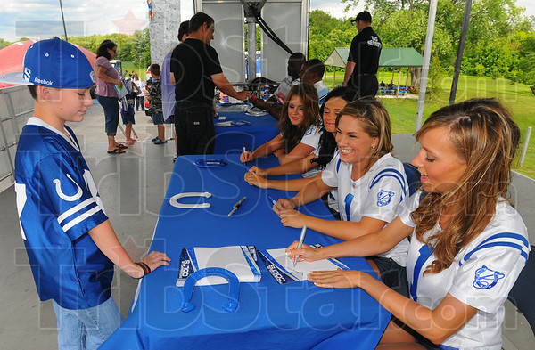 Tribune-Star/Jim Avelis<br /> Autograph hound: Dalton Mullendore gets autographs from Colts cheerleaders Wednesday evening at Harrison College.