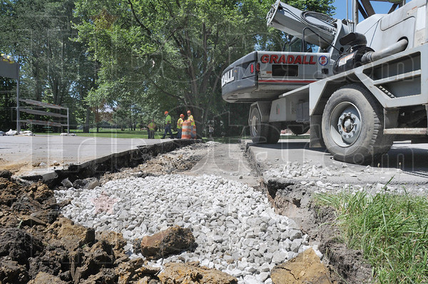 Tribune-Star/Jim Avelis<br /> Split decision: Repairs are under way on US40 near the Vigo Clay county line. A dip in the road caused the need for the work. A temporary fix should be in place by this evening, with a permanent repair taking place after the holidays.