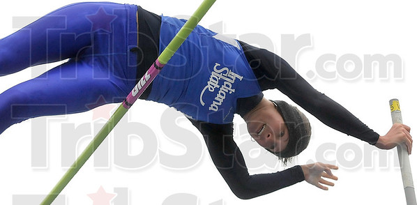 Tribune-Star/Joseph C. Garza<br /> Raising the bar and clearing it: Indiana State's Kylie Hutson clears the bar as she competes in the pole vault Saturday during the Indiana State Track & Field Invitational at Marks Field.