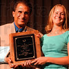 Winner: Kylie Hutson (right) poses with Danny Tanoos after accepting the McMillan award for outstanding female athlete in 2005.