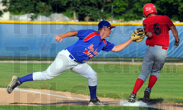 Tribune-Star/Jim Avelis<br /> Game of inches: Jimmy Maxwell can't make the tag for Post 346 as St. Bernice batter Jeremy Elden(6) reaches first safely on a throwing error.
