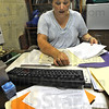 Tribune-Star/Jim Avelis<br /> Memories: Deanna Franklin clears up paperwork on her desk at the Purdue Extension office Wednesday afternoon. After 7+ years of work here, she is moving on to a job in Illinois.