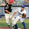 Back: Rex first baseman Mitch Osnowitz waits for an incoming throw during game action Wednesday night.