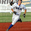 Three bagger: Rex player Chris Manning rounds second base enroute to a triple during game action Wednesday night.