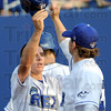 Score: Chris Manning gets congratulated after scoring the first run of Wednesday's Rex game at Bob Warn Field.
