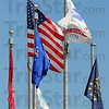 Tribune-Star/Jim Avelis<br /> Symbols: The American flag flies in front of the Vigo County courthouse with several other flags. The Indiana and Vigo county flags are there along with flags representing each branch of the Armed Services. A POW-MIA flag is also among them.