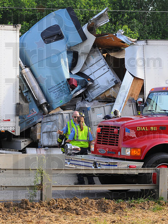 Tribune-Star/Jim Avelis<br /> Torn away: The cab of one of the semitrailers involved in a Monday evening crash on Interstate 70 was crushed under the weight of its own load that broke through the front of its trailer.