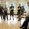 "Classroom: Members of the Terre Haute fire department gather at the end of Monday's training exercise for techniques of fighting ""high rise"" fires. At right is battalion Chief Bob Kiefner."