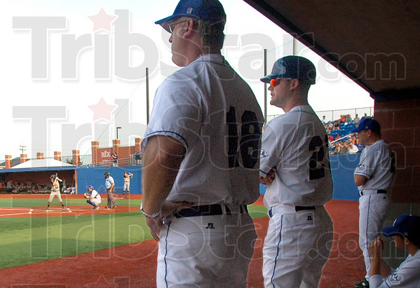Concerned: Coaches Brian Dorsett and Jeff Brown communicate during Monday's game against Hannibal. The team was down 1-0 in the first inning.