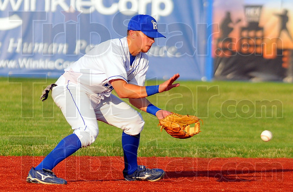 Tribune-Star/Jim Avelis<br /> Local product: Cameron Fagg, Rex second baseman and West Vigo High School product, stops a ground ball against Quincy Monday evening at Bob Warn Field.