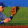 Tribune-Star/Jim Avelis<br /> Good glove: Koby Kraemer stops a one hop ground ball in the Rexs' game with Quincy Monday evening.