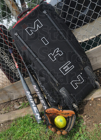 Tribune-Star/Rachel Keyes<br /> Ready for action: Kevin Kull's gear sits leaned up against the fence at Spencer Ball Park as Kevin starts batting practice.