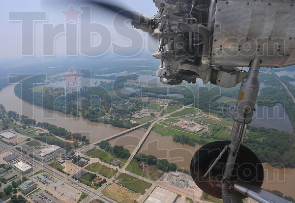 Tribune-Star/Jim Avelis<br /> Wings over the Haute: The Dresser and Dreiser bridges over the Wabash can be seen in this view from the pasenger cabin of the Ford Tri Motor as it loops around Terre Haute Monday afternoon.