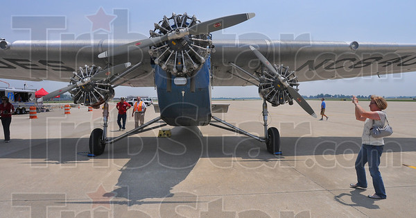 Tribune-Star/Jim Avelis<br /> Details: Karen Gray photographs the Ford Tri Motor for her husband Charles, an avid radio control model flyer and a builder of scale model planes.