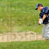 Blast: Shakamak's Eamon Eccles hits a shot from the bunker during sectional play Tuesday morning.