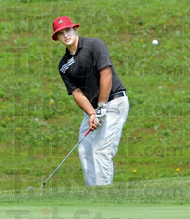 Eye on the ball: Thomas Goss of Terre Haute South watches his shot to the green during Tuesday's sectional action at Rolling Hills golfcourse near Spencer, Ind.