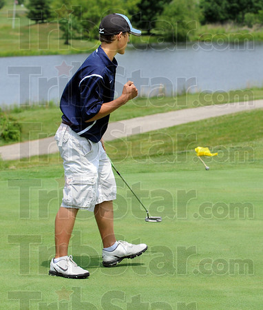 Yes:  Shakamak's Eamon Eccles reacts to sinking a long putt on the 5th hole at Rolling Meadows golf course in Gosport, Indiana Tuesday morning.