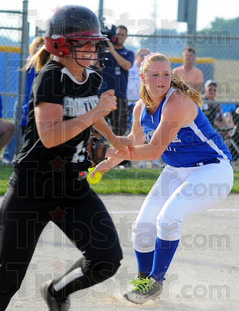 Tribune-Star/Jim Avelis<br /> Infield out: Rockville pitcher kayle Wilson sets to throw to first base to get Frontier batter Savanna Gaumer out.