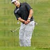 Final hole: Thomas Goss chips a shot to the 9th green during action Tuesday at The Legends Golf Course in Franklin, Ind.