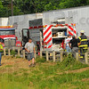 Tribune-Star/Jim Avelis<br /> Help: Sugar Creek volunteers and law enforcement officers work the accident scene Monday evneing near the 4 mile marker on I-70.