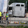 Tribune-Star/Jim Avelis<br /> Safe now: One of the victims of the chain-reaction accident on I-70 Monday evneing waits for transport to an ambulance.