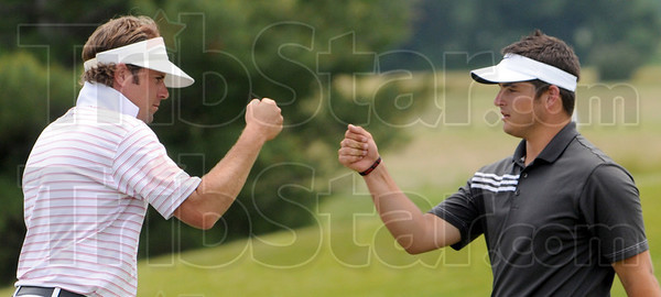 Fist bump: South coach Chris Cassell (L) congratulates his number one player Thomas Goss after Goss finished his round Tuesday afternoon.