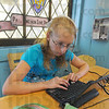 Tribune-Star/Jim Avelis<br /> Close to home: Jacklyn Correll logs on to the internet with her own computer using the library's Wifi connection in West Terre Haute. She like the easy access to the branch since it is so close to her home.