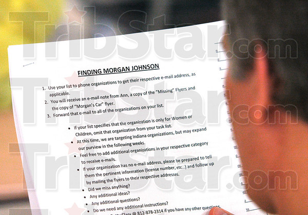 Finding Morgan Johnson: A participant reads a handout at the organizational meeting Tuesday morning.