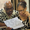 Concerned:  Herman and Evelyn Knox of Terre Haute read information about missing resident Morgan Johnson during Tuesday's organizational meeting at Sarah Scott Middle School.