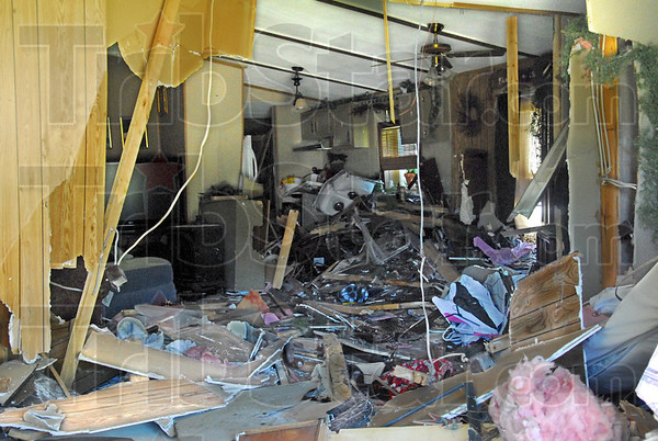 Fatal accident: The interior of the home located in Mecca, Indiana shows the path of the vehicle that entered the home passing through the bedroom and stopping in the kitchen.