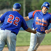 Homer handshake: Post 346 manager John Hayes extends his hand to Caleb Mason as he rounds third base after hitting a bases loaded home run during game action Tuesday night.