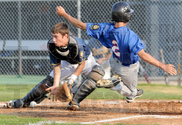 Score: Post 346's #2, Nick Long beats the throw to the plate and scores the first run of Tuesday's game against Danville.