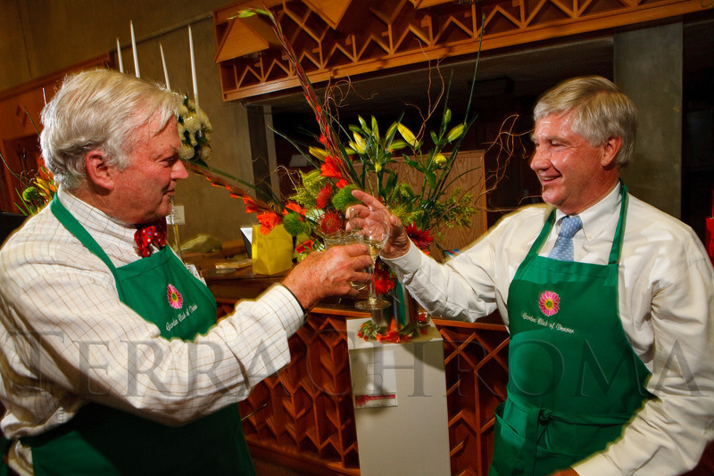 (Denver, Colorado, June 2, 2011)<br /> Ed Connors and Brewster Boyd toast the completion of their arrangement.  Garden Club of Denver event at the Denver Botanic Gardens in Denver, Colorado, on Thursday, June 2, 2011.<br /> STEVE PETERSON