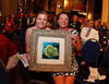 (Denver, Colorado, June 9, 2011)<br /> Melissa and Debbie Fenoglio with art by Tammi Otis from their winning bid, which was paired with Dr. Mike Fenoglio's artwork.  ThThe 17th annual Memories in the Making Art Auction, benefiting the Alzheimer's Association of Colorado, at Invesco Field at Mile High near the Denver, Colorado, on Thursday, June 9, 2011.<br /> STEVE PETERSON