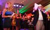 (Littleton, Colorado, June 24, 2011)<br /> Emcee Amelia Earhart, and live auctioneer, Gary Corbett.  The Del Frisco's - Sullivan's Black Tie Ball, benefitting Denver Active 20-30 Children's Foundation, at Polo Reserve Development in Littleton, Colorado, on Friday, June 24, 2011.<br /> STEVE PETERSON