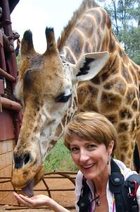 Paula feeding Helen at the giraffe sanctuary in Karen, Nairobi.