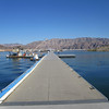 "HERE'S A LONG DOCK...LAKE MEAD, NEAR LAS VEGAS. IF YOU HAVE A BOAT DOCKED HERE, THE MARINA FURNISHES A SHUTTLE- BOAT 7 DAYS A WEEK TO TAKE YOU TO ""YOUR"" BOAT DUE TO THE LENGTH OF THE DOCK SYSTEM"