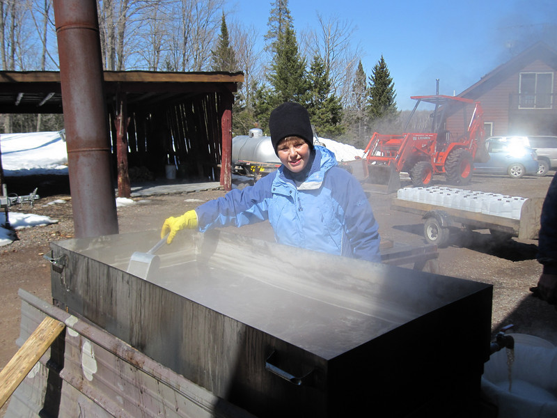 """PAM IS """"SKIMMING"""" FOAM OFF THE TOP OF THE MAPLE SYRUP AS IT COOKS"""