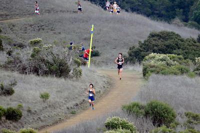 When the runners cleared the 2-mile flag pole, there had been a juggling of the order of the top three runners. Richard Ho was still solidly in the lead but now it was Aubrey who was in second, about 30 meters back.