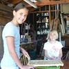 Ronja and Amaja helping spin the honey