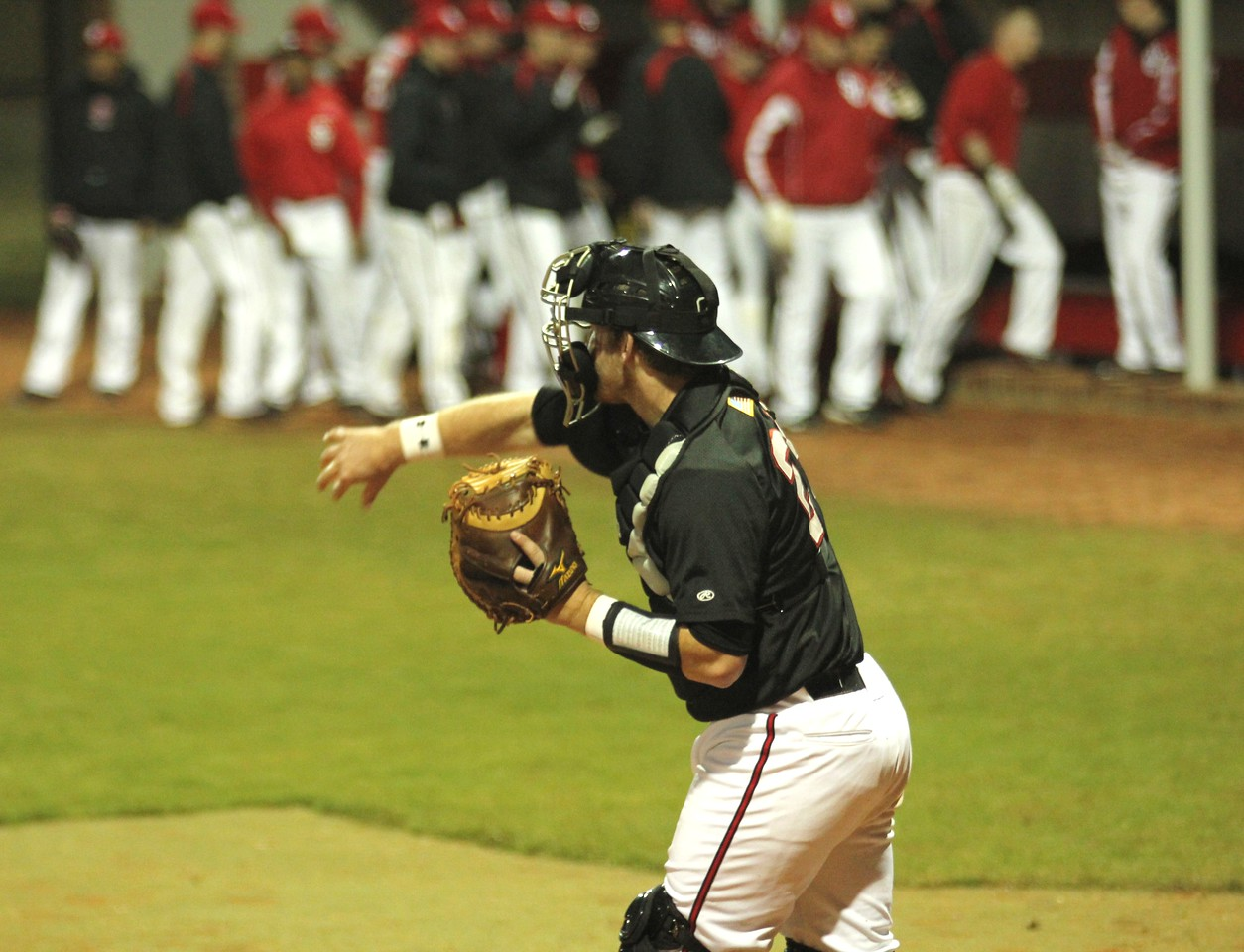 #28 John Harris throws to the pitcher in the first night game to be played at GWU.